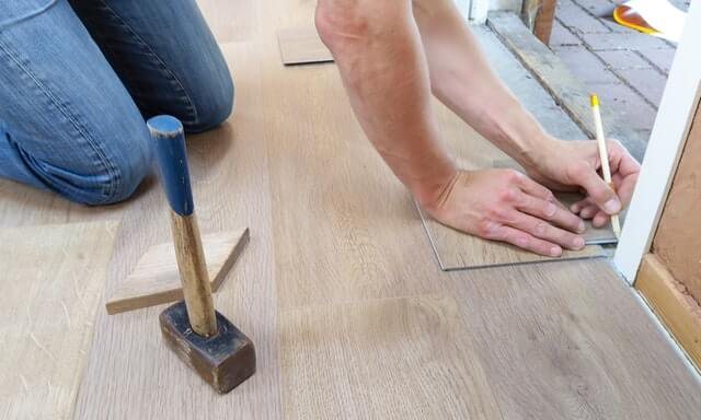 assignment of benefits - carpenter working on floor